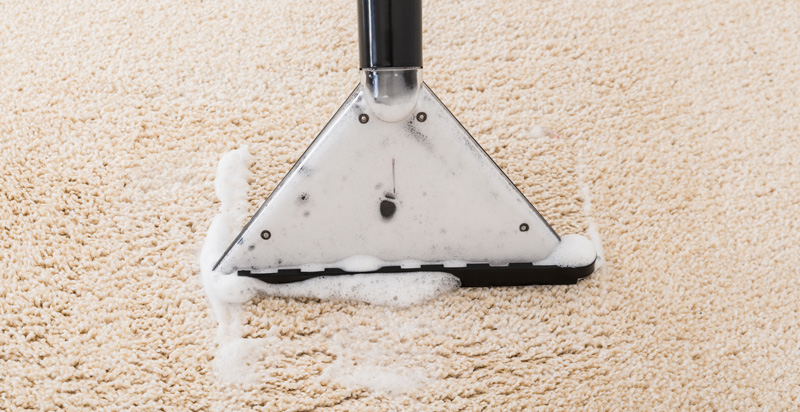 carpet-being-cleaned-with-vacuum